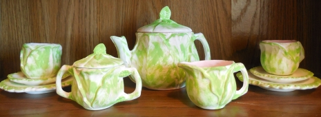 11 Piece Finished Vintage Cabbage Child Teapot Set Adorable vintage teapot wrapped with cabbage leaves. Excellent condition. Please view pictures for close up details. Perfect vintage teapot for any home or collection! Comparison Price $100.00 My Price $50.00