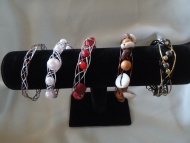 Item #18 celtic weave ,#19 Pink pearl ,#20 Red, #21 Wood ,#22 Black--- $5.00